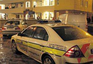 Garda officers cordon off the scene of the double killings in Pearse House, off Pearse Street, in Dublin, last night