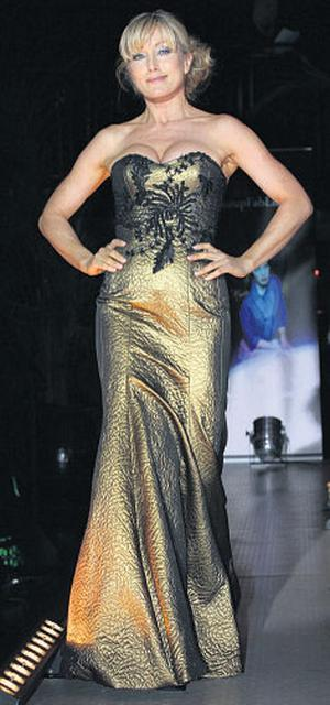 Una Gibney wears an evening ensemble by Synan O'Mahony