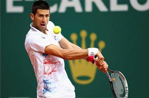 Novak Djokovic of Serbia plays a backhand in his match against Alexandr Dolgopolov of Ukraine during day five of the ATP Monte Carlo Masters. Photo: Getty Images