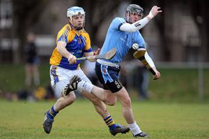 Joe Downey of UUJ tries to get away from John Joe Farrell (St Patrick's Mater Dei) at the Na Fianna grounds in Glasnevin.