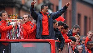 Edwin van der Sar, Dimitar Berbatov and Luis Nani pictured at the front of the open-top bus. Photo: PA