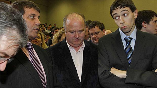 Wicklow Fine Gael candidates Andrew Doyle, Billy Timmins and Simon Harris listen as the results are called out at the count in Greystones, Co Wicklow