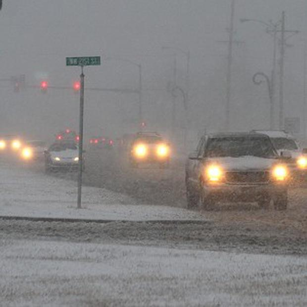 A blizzard has brought snow and ice to many parts of the US (AP)