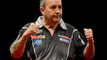 22 March 2011; Phil Taylor celebrates winning the opening leg against James Wade during the McCoy's Premier League Darts Tournament. O2, Dublin. Picture credit: Stephen McCarthy / SPORTSFILE