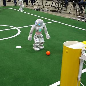 A robot aims during a penalty shootout at the robot football world cup (University of Edinburgh/PA)