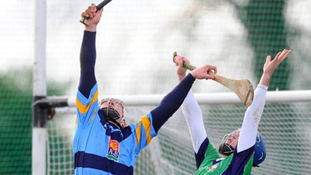 UCD'S Liam Rushe contests a high ball with Ciarán Cowan of Limerick IT during yesterday's Fitzgibbon Cup tie at Belfield. Photo: Dáire Brennan / Sportsfile