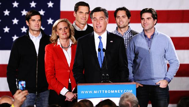 Republican presidential hopeful Mitt Romney (C-on stage) speaks during his caucus night rally following republican caucuses in Des Moines, Iowa. Photo: Getty Images