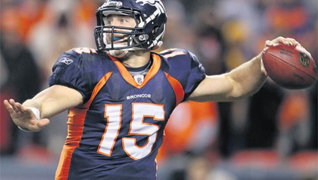 Denver Broncos' Tim Tebow winds up as he looks to pass to Demaryius Thomas