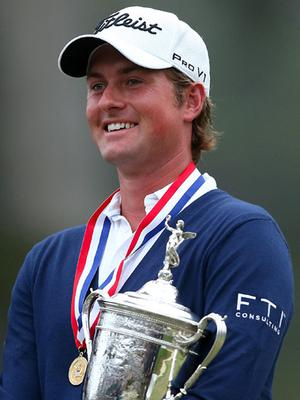 Webb Simpson of the United States poses with the trophy after his one-stroke victory at the 112th U.S. Open. Photo: Getty Images