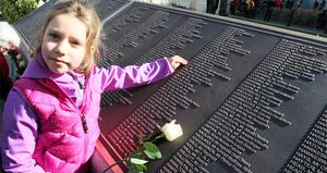 Alex Aaronson 6, from north America, whose descendant Artie Frost 38, perished on the Titanic, in the new memorial garden at Belfast City Hall