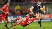 Man of the match Jamie Heaslip plows through the challenge of Ronan O'Gara during last night's Thomond Park clash
