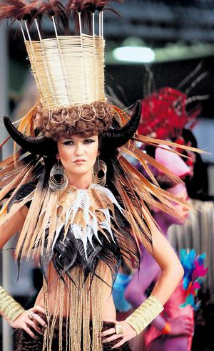 Model Ciara McStrawick with a design called 'Tribal' during the Fantasy section at the OMC European Championships in Hair & Beauty in RDS.GARETH CHANEY