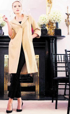Sarah Morrissey wears Rosie gold coat (€1,295) and Krista cropped wool trousers (€350) from the Louise Kennedy autumn/winter 2012 collection.