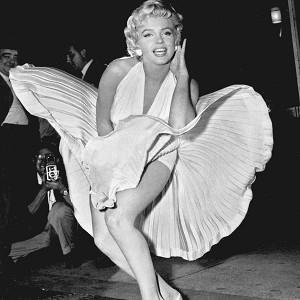 """The Marilyn Monroe dress that flirted revealingly with a gust of New York subway air in """"The Seven Year Itch""""  fetched 4.6 million dollars at auction(AP)"""