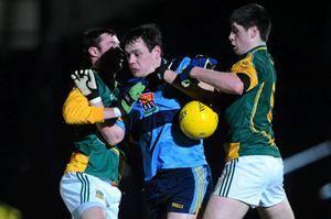 UCD's John O'Loughlin attempts to get past Meath duo Cormac McGuinness, left, and Conor Gillespie at Pairc Tailteann last night. Photo: Stephen McCarthy / Sportsfile