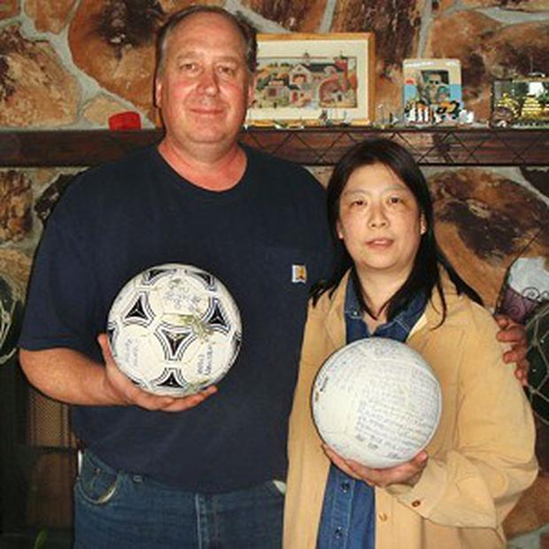 David and Yumi Baxter found the football at their home in Alaska after it drifted there following the quake (AP)