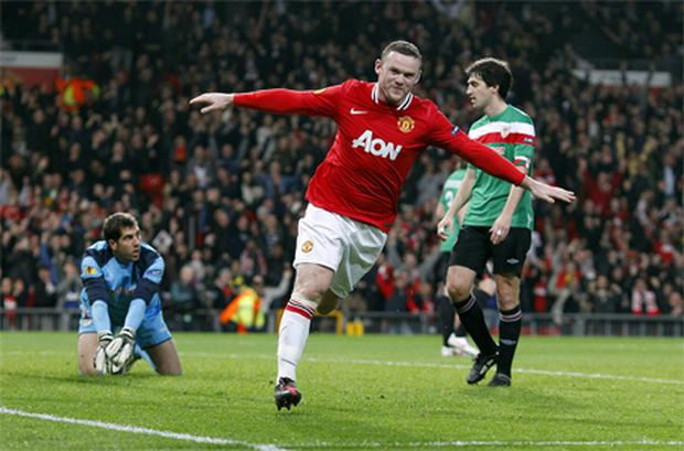 Wayne Rooney wheels away after scoring the first goal of the night at Old Trafford. Photo: PA