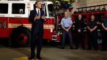 President Barack Obama talking with firefighters as he visits the Engine 54 Ladder 4 New York Fire Department