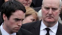 Cork air-crash survivors Donal Walsh (left) and Lawrence Wilson (right) outside the church after the funeral Mass of Brendan McAleese