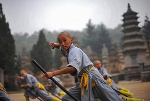 For the 60,000 young would-be kung fu stars kicking and punching away at the schools around the temple, Shaolin kung fu offers a way out of poverty. Photo: Getty images