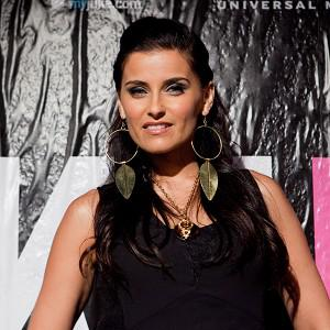 Nelly Furtado says she was once advised to have breast implants