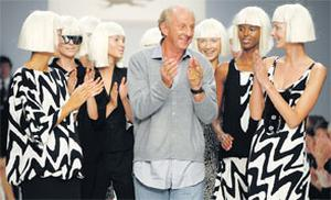 ROUND OF APPLAUSE: Paul Costelloe, above after a successful London show, takes no prisoners, including Neil Delamere. The designer objected to the comedian's Royal gibe on grounds of taste, but he is also close to the Royal family, having designed Zara Phillips' outfit, for the Royal wedding