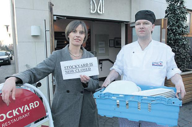 Louise Aungier, owner of the Stockyard restaurant in Clontarf, Dublin, with head chef Matt Halpin cleaning out the premises after shutting down