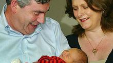 Gordon Brown and his wife, Sarah, with their son Fraser Brown