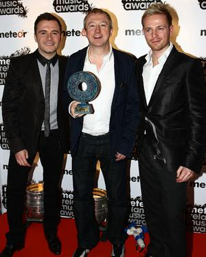 Westlife member Shane Filan, Louis Walsh and Westlife member Nicky Byrne appear in the Meteor Ireland Music Awards press room after winning the Best Irish Pop Act award on March 17, 2009 in Dublin, Ireland <b>Photo:</b> Getty Images