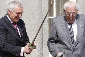 Bertie Ahern and Northern Ireland's First Minister Ian Paisley hold swords during the official opening of the Battle of the Boyne site in Drogheda on May 6, 2008