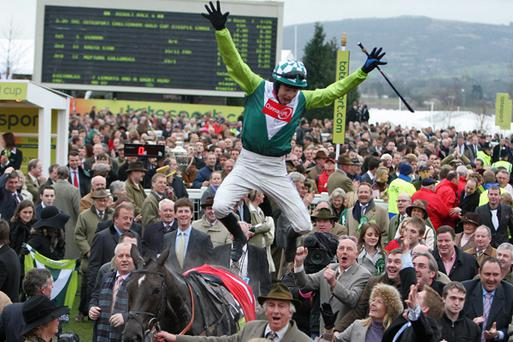 Sam Thomas jumps from Denman as he celabrates winning the Totesport Cheltenham Gold Cup. Credit: Phil Cole, Getty Images