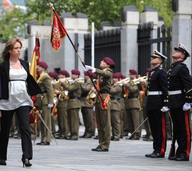 Spain's first female Defence minister, Carme Chacon, reviews the troops after being sworn into office. Credit: Javier Soriano, Getty Images