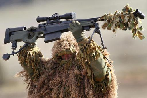 An Australian Army sniper displays his weapon during a training exercise at the Puckapunyal Army Area, some 125 kilometres north of Melbourne on May 8, 2008. The live fire excercise included tanks, armoured vehicles, artillery, missiles and small arms and showcased the lastest weapons to senior Army officers