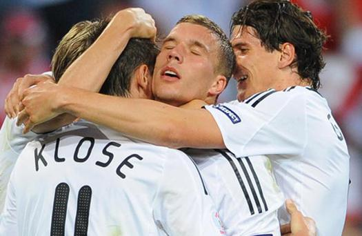 German forward Lukas Podolski (C) celebrates after scoring with team-mates German forward Miroslav Klose (L) and German forward Mario Gomez (R) during their Euro 2008 Championships Group B football match Germany vs. Poland on June 8, 2008 at Woerthersee stadium in Klagenfurt, Austria. Credit: Alberto Pizzoli, Getty Images