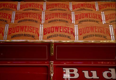Wooden beer cases are seen on display inside a stable for the Budweiser Clydesdales during an Anheuser-Busch Cos. brewery tour July 14, 2008 in St. Louis, Missouri. Anheuser-Busch Cos. Inc.'s board of directors voted Sunday to accept Belgian brewer InBev's takeover offer of $52 billion. Photo: Whitney Curtis/Getty Images