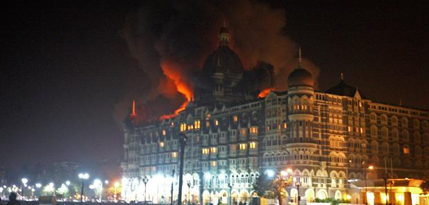The Taj Mahal Palace Hotel was set alight trapping dozens inside. Photo: Pal Pillai, Getty Images