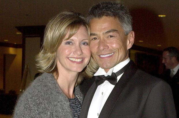 Actress Olivia Newton-John poses with her boyfriend Patrick McDermott at the 10th Annual Human Rights Campaign Gala, February 17, 2001 in Los Angeles, CA
