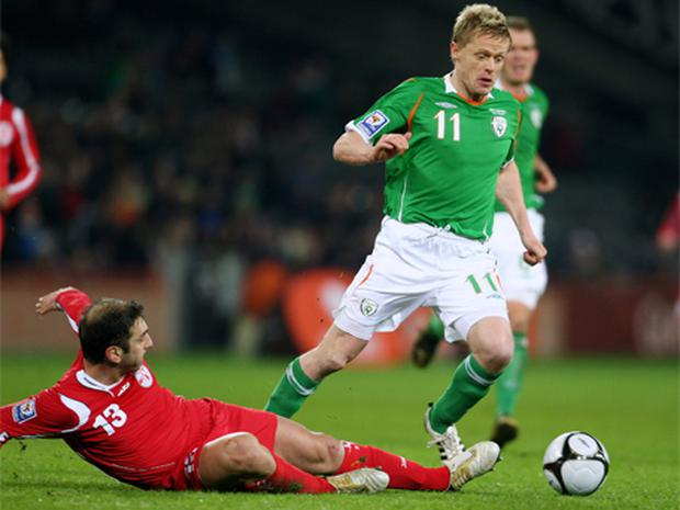 Damien Duff of Republic of Ireland avoids a challenge by Zurab Khizanishvili of Georgia during the FIFA 2010 World Cup European Qualifying match between the Republic of Ireland and Georgia at Croke Park on February 11, 2009 in Dublin, Ireland. Photo: Phil Cole, Getty Images