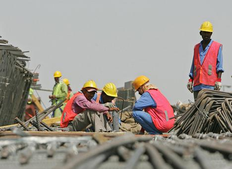 Foreign employees work at a construction site in Dubai. Photo: Getty Images