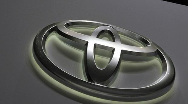 The logo of Japanese carmaker Toyota is seen during the first media day of the 79th Geneva Car Show on March 3, 2009 in Geneva. Photo: Fabrice Coffrini, Getty Images