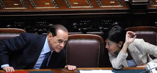 Italy's Prime Minister Silvio Berlusconi speaking with Equal Opportunities Minister Mara Carfagna in the parliament in Rome