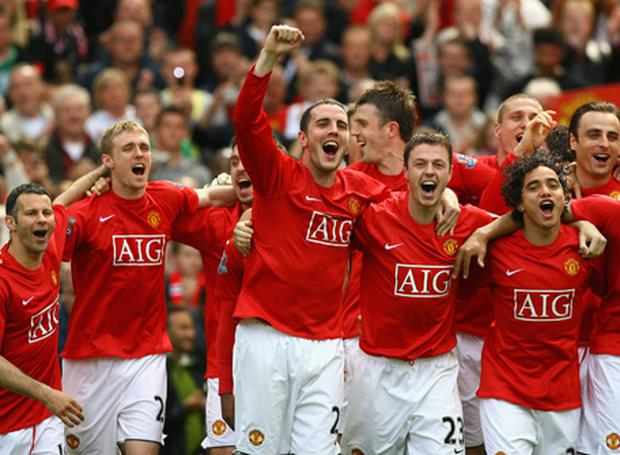 f86d83d1a The Manchester United players celebrate after their team clinched the  Premier League title. Photo