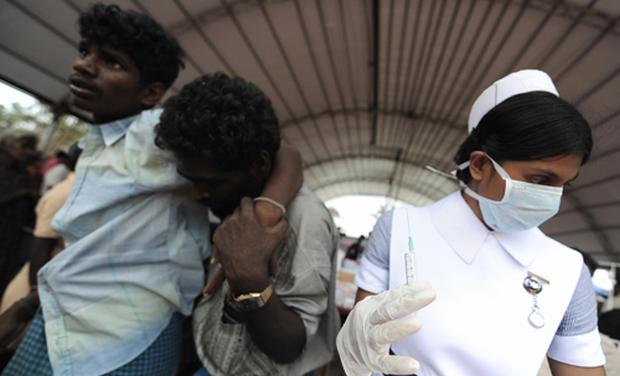 A nurse treats patients at a makeshift hospital for internally displaced Sri Lankan people at Menik Farm refugee camp in Cheddikulam. Photo: Getty Images
