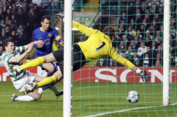 Ryan Giggs scores past Artur Boruc to equalise with Celtic at Celtic Park