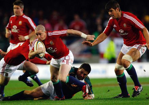 Lions winger Shane Williams bursts through the defence. Photo: Stu Forster, Getty Images