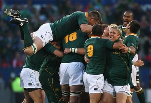 Morne Steyn of South Africa is mobbed by his team mates after kicking the match and series winning penalty during the Second Test match between South Africa and the British and Irish Lions. Photo: Alex Livesey, Getty Images