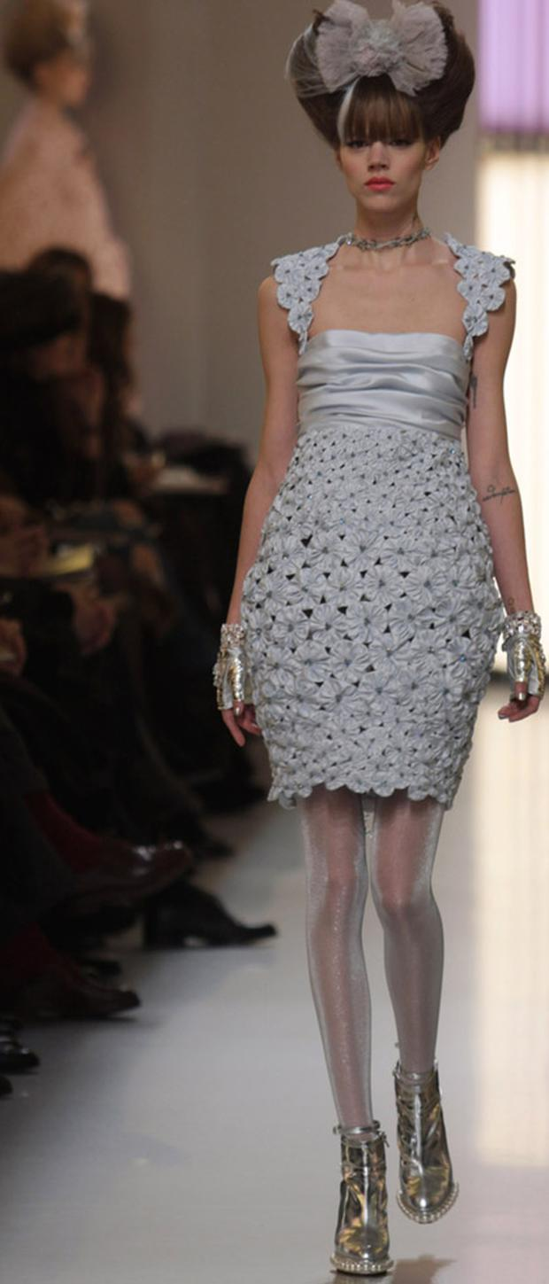 A model wears a stunning cocktail dress during Paris Fashion Week Haute Couture S/S 2010 - Chanel. Photo: Getty Images