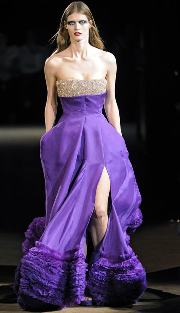 A model wears a stunning purple gown at the Givenchy fashion show during Paris Haute Couture Fashion Week Spring Summer 2010. Photo: Getty Images