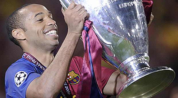 Thierry Henry celebrates winning the Champions League with Barcelona last season. Photo: Getty Images