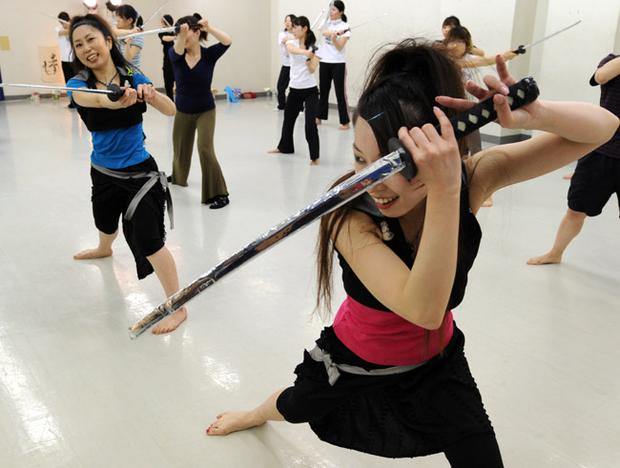 'Katana Exercise' student Ayako Tomomitsu practices during a fitness lesson at a studio in Tokyo. Photo: Getty Images